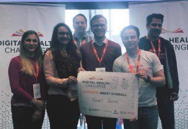 Sascha Rudolph and NovelSense team accepting award for winning a hackathon in Nuremberg