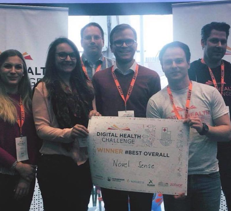 Sascha Rudolph and NovelSense team accepting award for winning a hackathon in Nuremberg