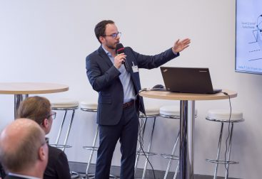 Sascha Rudolph presenting the ParkCheck AI project at a mobility conference in Berlin